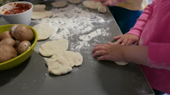 Children hands wide pizza dough Stock Footage