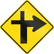 New Zealand road sign - Crossroads ahead (priority turns right) - stock illustration