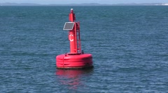 Red safety buoy on water for navigation Stock Footage