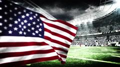 American flag blowing in football stadium Stock Footage