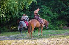 Zaporizhzhya Cossacks on horseback against a background of trees Stock Photos