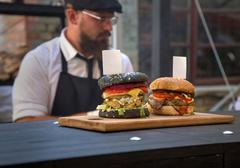 Closeup of homemade hamburger with fresh vegetables Stock Photos