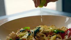 Lime squeeze on Thai food, drunken seafood spaghetti Stock Footage
