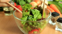 mixing diet salad with wooden spoons - stock footage
