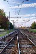 The rails of the railway in the long term with a beautiful sky in autumn Stock Photos