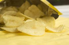 potato chip fat cholesterol salted junk fast food concept - stock photo