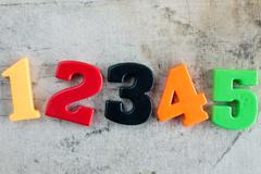 Colored numbers  on canvas background Stock Photos