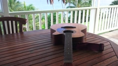 Guitar on teak table on lanai   ,Hawaii  Stock Footage