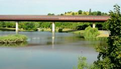 View of the tunnel for metro above the large pond near by the green park - metro Stock Footage