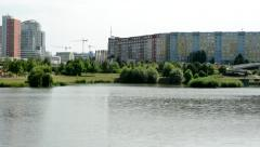 Buildings estate under construction near by the large pond in the city Stock Footage