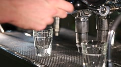 Water pouring from espresso coffee machine - stock footage
