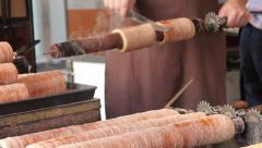Traditional Czech and Hungarian sweet bakery trdelnik cooked on the street. Stock Footage