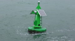 Green buoy on water for safe shipping Stock Footage