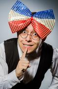 Stock Photo of Funny man with giant bow tie