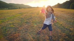 Small pilot playing on the meadow Stock Footage