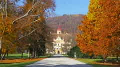 Beautiful autumn alley of Unesco heritage site Eggenberg Palace, Graz, Austri Stock Footage