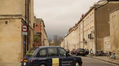 Black taxi cab in Oxford town centre street, England, Europe Stock Footage