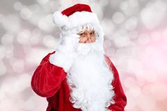 Santa Claus over sparkle abstract background. Stock Photos