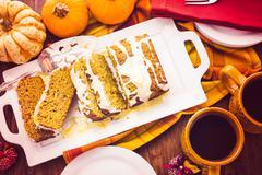 Homemade pumpkin bread with orange glazing on top. Stock Photos