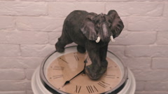 Statuette of an elephant standing on the watch dial and spinning. Stock Footage