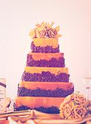 Gourmet tiered wedding cake as centerpiece at the wedding reception. - stock photo