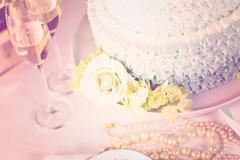 Gourmet tiered wedding cake as centerpiece at the wedding reception. Stock Photos