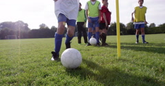 Group of Caucasian boys practising before their football match. Arkistovideo
