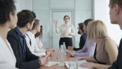 Business people in a conference hall waiting for leader - stock footage