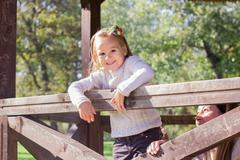 Happy little girl in the park. Autumn season. Stock Photos
