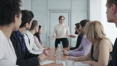 Business people in a conference hall waiting for leader. Slow motion - stock footage