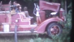 Old Vintage Film !956 Red Fire Truck Pumping Water Hose Spray Water Stock Footage
