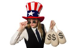 Woman with money sacks isolated on white Kuvituskuvat