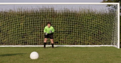 Stock Video Footage of A goalkeeper makes a save from a penalty kick. Shot in slow motion on RED Epic.