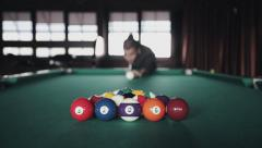 Man playing pool billiards first shot Stock Footage