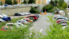 View of the carpark in the suburb surrounded by many prefab houses Stock Footage