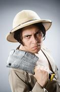 Stock Photo of Funny safari traveller in travelling concept