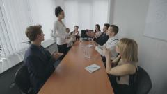 Group of business people appreciating businessperson at presentation Stock Footage