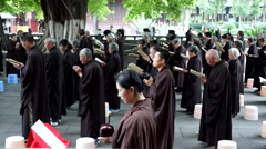 believers chanting and praying in a temple - stock footage