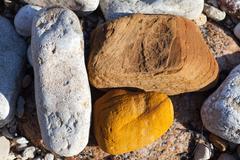 Three stones of different colors Stock Photos