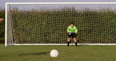 A young boy scores a goal during a penalty shoot out. Shot on RED Epic. - stock footage