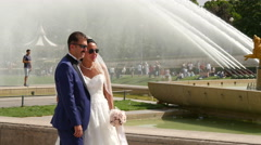 Wedding couple having a photo session next to the Fountain of Warsaw, Paris Stock Footage
