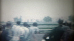 1969: Horseracing finishing line and winner prancing around after race. Stock Footage