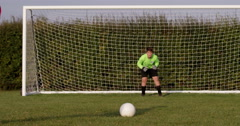 Stock Video Footage of A young boy scores a goal during a penalty shoot out. Shot on RED Epic.