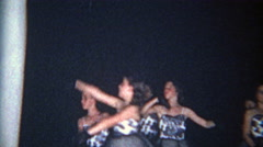 1966: Young girl dancing with company in black evening gown attire. Stock Footage
