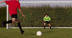 A young boy scores a goal during a penalty shoot out. Shot on RED Epic. Stock Footage