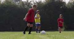 Group of boys  training before their soccer match. Shot on RED Epic. - stock footage