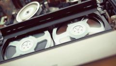 Rotation reels with video tape on the video tape recorder / player. Macro Stock Footage