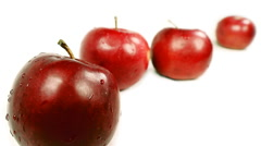 Juicy Red Apples rack focus on white backdrop Stock Footage