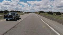 Driver On Interstate 40 Being Passed By Classic 1950s Muscle Car Arkistovideo