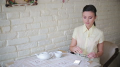 Business lady solves business matters by phone at cafe Stock Footage